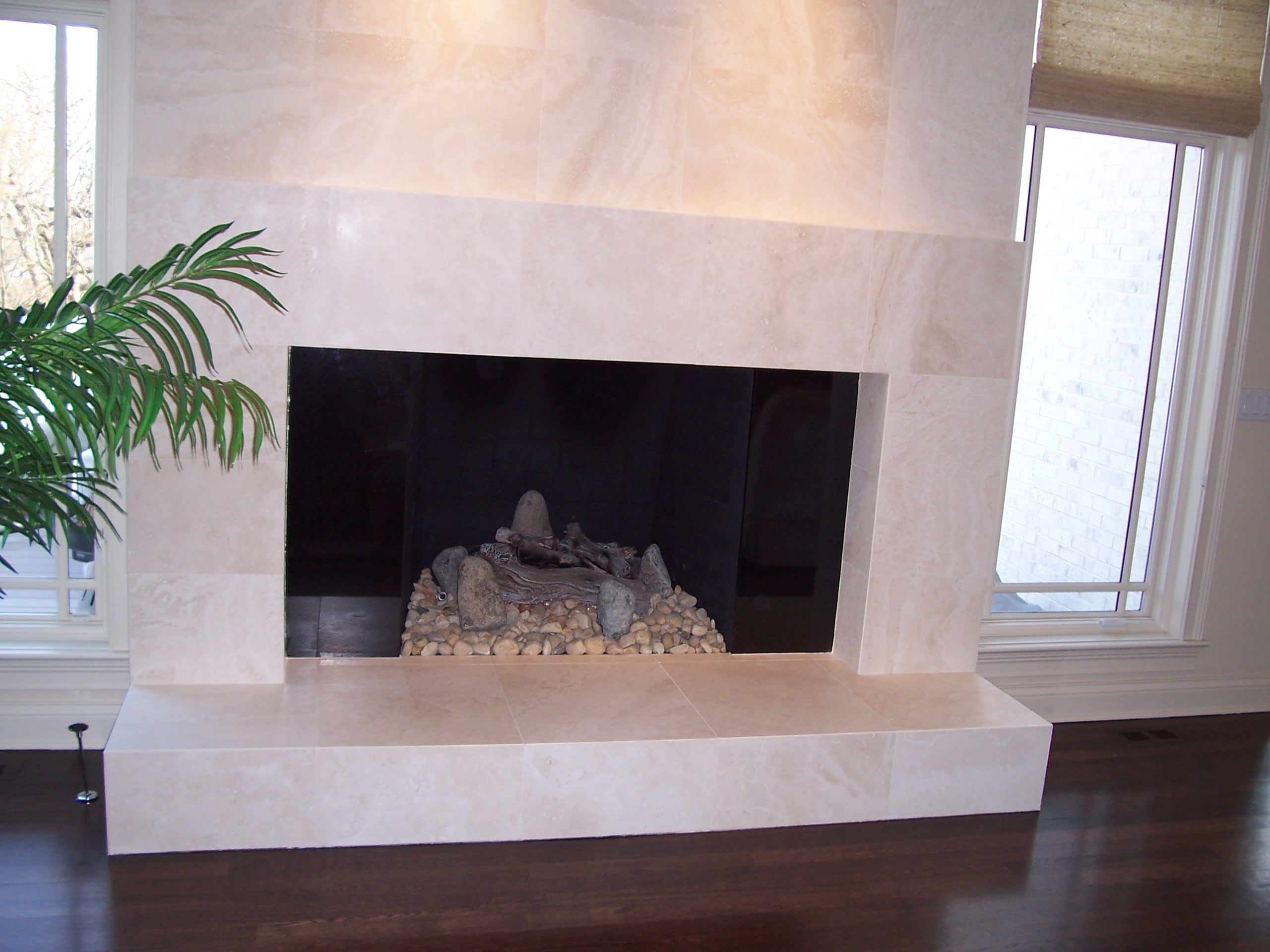 Why natural stone is perfect for fireplaces nalboor - Tile over brick fireplace ...